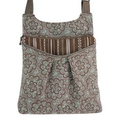 """Maruca Busy Body handbag in Piccadilly.  The sling with a boho vibe. Soft adjustable custom strap. Interior with small pocket. Open exterior pocket for quick access. 9"""" x 9.5"""" x 2"""" Strap drop length: 12"""" - 24"""" Web strap width: 1"""" Handmade in Boulder, CO. Shop The Handbag Store in store at 253 Main St, Hill City SD or online at www.shopthehandbagstore.com."""