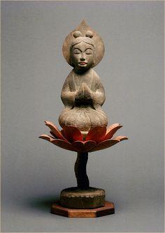 Anjali mudra, gesture of praying. Smiling celestial maiden seated on lotus, Hotokeshi Gallery, Japan.