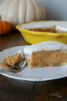 This Pumpkin Chiffon Pie is the perfect ending to your Trim Healthy Thanksgiving Dinner! Light, creamy and smooth, it's a no special ingredient S.