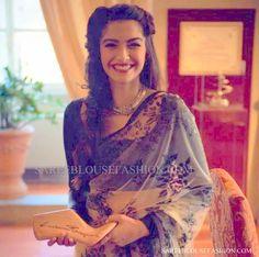Celebrity in black semi formal designer saree