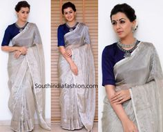 For a recent event, Nikki Galrani wore a plain silver tissue saree with contrast blue raw silk elbow length sleeves blouse by Anju Shankar. She styled her look with silver jewellery by Prade jewels, blue bindi and a gajra bun! Onam Saree, Kerala Saree Blouse Designs, Sari Dress, Anarkali Dress, Saree Trends, Saree Models, Fancy Blouse Designs, Organza Saree, Stylish Sarees