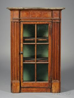 Federal Pine Glazed Architectural Wall Cupboard, possibly Cape Cod, Massachusetts, early 19th century, with a frieze of three panels, and flanking engaged reeded pilasters, the door opening to three shelves, old refinish, (imperfections), ht. 42 1/2, cabinet wd. 25, dp. 12 1/2 in.