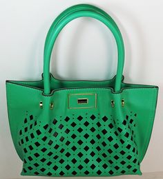 418737b98a A gorgeous green finish handbag that will go with virtually everything in  your closet. Shop