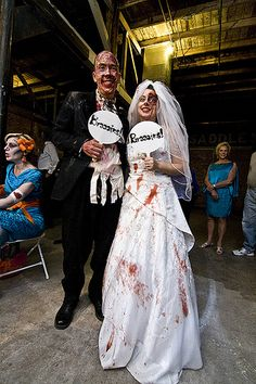 This whole wedding is adorable and fun. And she wears two dresses. And someone does gory makeup for guests at the reception. And her bouquet is made out of brooches and bones. Come on!