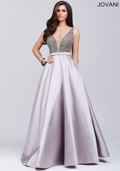 Elegant sleeveless ballgown features a plunging back and poly-satin skirt