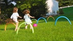 set up pool noodles for a game of kickball croquet