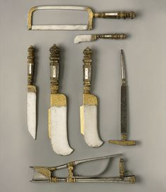 French pruning tools from 1500s - Forged and decorated in Moulins, this partly gilded steel set of gardening implements, enhanced by mother-of-pearl, is engraved with motifs of fruit and foliage. The set includes billhooks for removing branches and clippers that could be mounted on a pole. A pruning knife, saw, and combination hammer and auger to cleave tree bark for bud grafts.