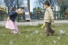 Young children on a playground Stock Photo