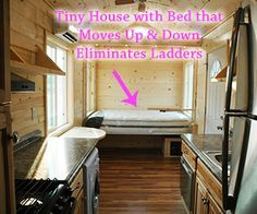 Tiny House with No Need for Loft or Ladder {bed is on a motorized lift!}.  This picture shows the bed down.  Lifted up, there is a sofa to sit on.