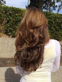 Lang geschichtetes zotteliges Haar