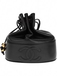 286b00200 View this item and discover similar handbags and purses for sale at - Black  leather vintage bucket bag from Chanel featuring a shoulder strap, a  drawstring ...