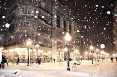 City snowfall night city lights winter street snow buildings