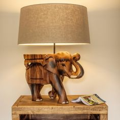 Surin Elephant Lamp carved with great skill from a single piece of monkey pod wood by our fair trade friends in Thailand. With subtle hand-painted features, a fabulous talking point for any room. Elephant Lamp, Charmed Characters, Monkey Pod Wood, Table And Chairs, Dining Tables, Coffee Tables, Dining Room, Hand Carved, Hand Painted