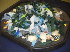 Under the Sea small world - with lots of torn strips of sea coloured tissue and crepe paper