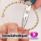 Tutorial - Videos: How to Add Beads and a Charm to an Expandable Charm Bangle made using the Artistic Wire 3D Bracelet Jig   Beadaholique