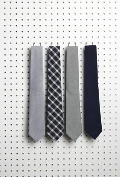 Sharp, but quiet ties. men should not dress too loud but rather let the woman hes with draw the attention for him.