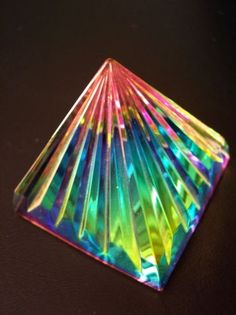 - new pyramidic refraction sparkle pyramids prism abstract light rainbow crystal color glass (click to view a larger image...)