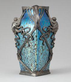 Loetz | A metal mounted Loetz iridescent glass vase - Art Nouveau.