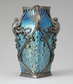 ❤ - Loetz | A metal mounted Loetz iridescent glass vase -  Art Nouveau.