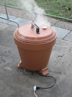 INSTRUCTIONS on HOW TO CREATE A SMOKER FROM TERRACOTTA FLOWER POT 1  Flower Pot 1    Flower Pot Drain Pan 1    Single Burner 1    Grill Grate 3    Flower Pot Feet 1    Fence Gate Handle 2    Screws Long Enough to hold it the handle through the lid 2    Nuts for the screws 4    Large Washers 1    Grill Thermometer 1    Masonry Drill Bit (of appropriate diameter) 1    Sheet Automotive Gasket Material  1    8 Cast Iron Skillet http://www.instructables.com/id/Flower-Pot-Smoker-Improved-Lid/?ALLSTEPS