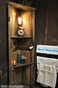 Rustic corner door shelf made from an old door.