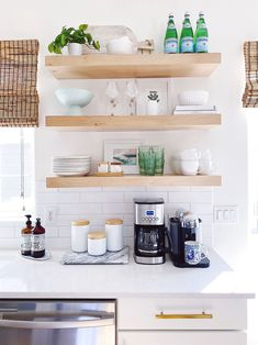 Our kitchen remodel included removing one of the upper cabinets and adding open shelving - jane at home Modern Coastal, Coastal Decor, Coastal Living, Coastal Homes, Coastal Style, Styling Bookshelves, Kitchen Lighting Fixtures, Light Fixtures, Declutter Your Home