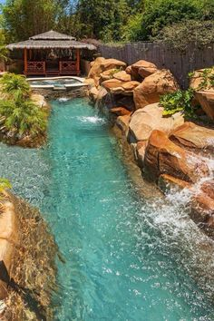 Tropical Pool With Cabana and Hot Tub -- A thatched roof cabana is the perfect spot to relax in the shade. Large boulder surround the pool and hot tub that features a stacked stone facade. Natural Swimming Pools, Swimming Pools Backyard, Pool Spa, Swimming Pool Designs, Natural Backyard Pools, Pool Cabana, Natural Pools, Tropical Pool Landscaping, Backyard Pool Designs