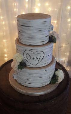 Tree trunk themed wedding cake