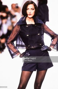 A model walks the runway at the Claude Montana Ready to Wear Spring/Summer 1991-1992 fashion show during the Paris Fashion Week in October, 1991 in Paris, France.