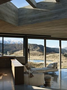 Underfoot, polished concrete floors echo the reflective water feature outside, and the Lake Wakatipu in the distance.