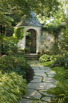 Shaded winding flat stone pathway to stone turret - idyllic!  Wadia-associates-architecture-landscape-architectural-details