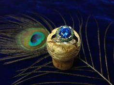 Tanzanite & Green Diamonds set into 14k white gold at Walter Guy Jewelers