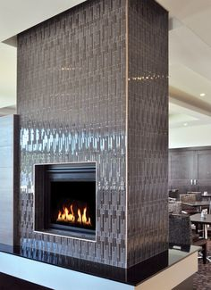 A Mid Century Modern Two Sided Fireplace Featuring Tile