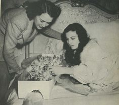 While on the set of Gone with the Wind, Vivien Leigh receives flowers from Laurence Olivier.