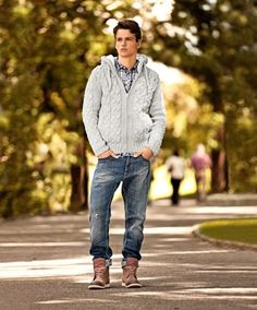 Shop this look on Lookastic:  https://lookastic.com/men/looks/grey-hoodie-white-and-navy-long-sleeve-shirt-navy-jeans-brown-boots/13074  — White and Navy Check Long Sleeve Shirt  — Grey Knit Hoodie  — Navy Ripped Jeans  — Brown Leather Boots