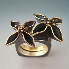 Ring | Anne Marie Cianciolo. Oxidized sterling silver, 18k yellow gold, 14k rose gold, diamond