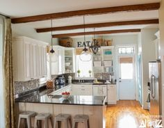 We could tear down the wall between our Kitchen and dining room and give it such an open feeling! Showing this to Nick