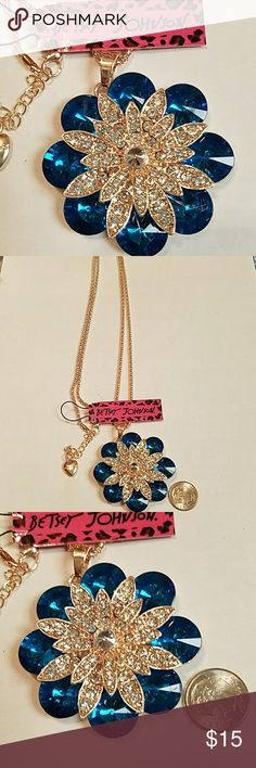 Gorgeous aqua blue crystal flower necklace This is absolutely beautiful aqua blue and clear crystal flower burst necklace 26in long gold tone. Absolutely beautiful inspired fashion jewelry Betsey Johnson Jewelry Necklaces