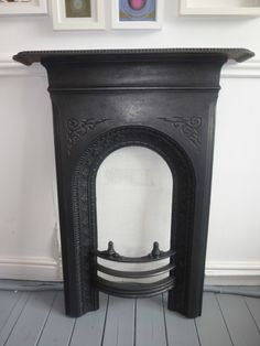 Victorian Cast Iron Fireplace from Ebay.     I would paint this a light colour for a girls bedroom.. white, maybe pink.     Height 95cm Width 53cm (70cm mantel)