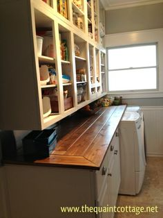 I love the wood countertop in the laundry room. Would look good in a pantry also.