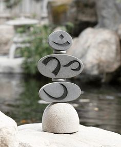 Stacked stone garden statue combines the iconography from two beloved symbols, Om and the Cairn, to create a unique art piece for the outdoors.