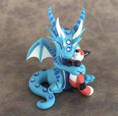 Fox Cuddles Sculpture by Dragonsandbeasties