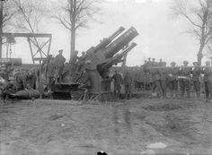 MINISTRY INFORMATION FIRST WORLD WAR OFFICIAL COLLECTION (Q 1990) A 15-Inch Howitzer is prepared for firing from a position near Dainville, 10 April 1917.