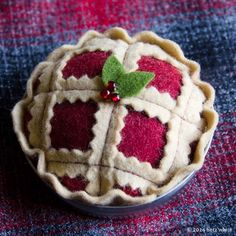 Make a sweet Christmas Pie Ornament with a mason jar lid serving as the pie pan. Or leave off the hanger loop to create a pincushion instead! Either way, it's a super cute hostess gift or tree décor. From Betz White
