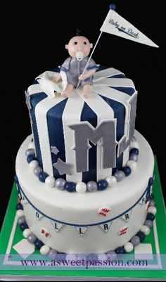 A Yankees inspired baby shower cake... complete with Yankees onesie flags!