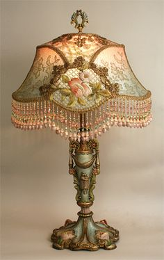 This is a French lamp in the Art Nouveau style from around the century. The floral embroidery featured on the exterior of the lampshade combined with the hand-painted lamp base creates a complex and interesting piece of lighting. Decor, Beaded Lampshade, Lamp, Beautiful Lamp, Vintage Lamps, Victorian Lamps, Victorian Home Decor, Painting Lamps, Victorian Decor