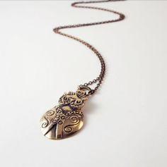 "Petra Tolonen for Turun Hopea, Modern vintage bronze ""Owl"" necklace, 1960s. #Finland   finlandjewelry.com #forsale"