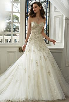 Brides: Sophia Tolli. Strapless sweetheart lace and misty tulle over sparkling diamond tulle full A-line gown. Hand-beaded lace appliqués adorn dropped waist bodice and cascade down skirt. Chapel length train and back corset. Removable spaghetti and halter straps included.