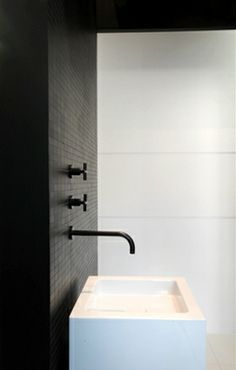 The big white tiles and the small black ones are great together.  I like the contrast a lot.  I think the black makes the space too dark but I like the idea