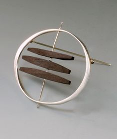 Brooch | Betty Cooke.  Sterling silver and ebony #SterlingSilverJewelry #SterlingSilverBrooches